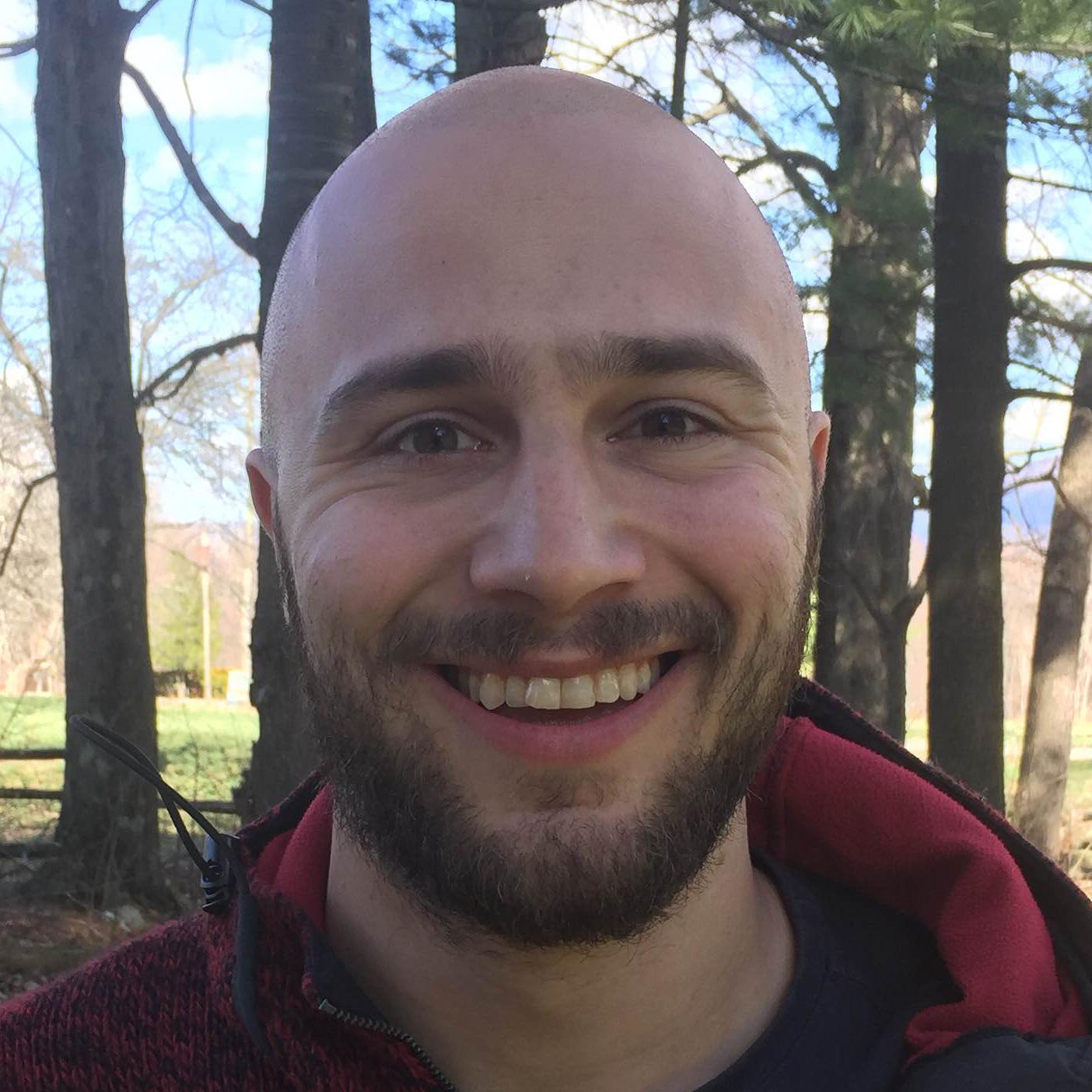 Headshot of Adam Plunkett