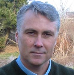 Headshot of Justin Spring